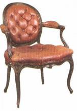 Rokokoo-tool nahk kate, sügavvolditud nööpidega.